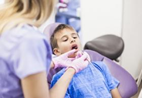 новообразование над молочным зубом